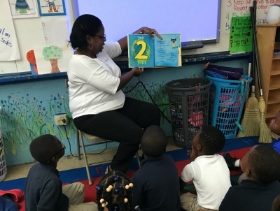 Special Visitor Reads to First Graders at Rosenwald